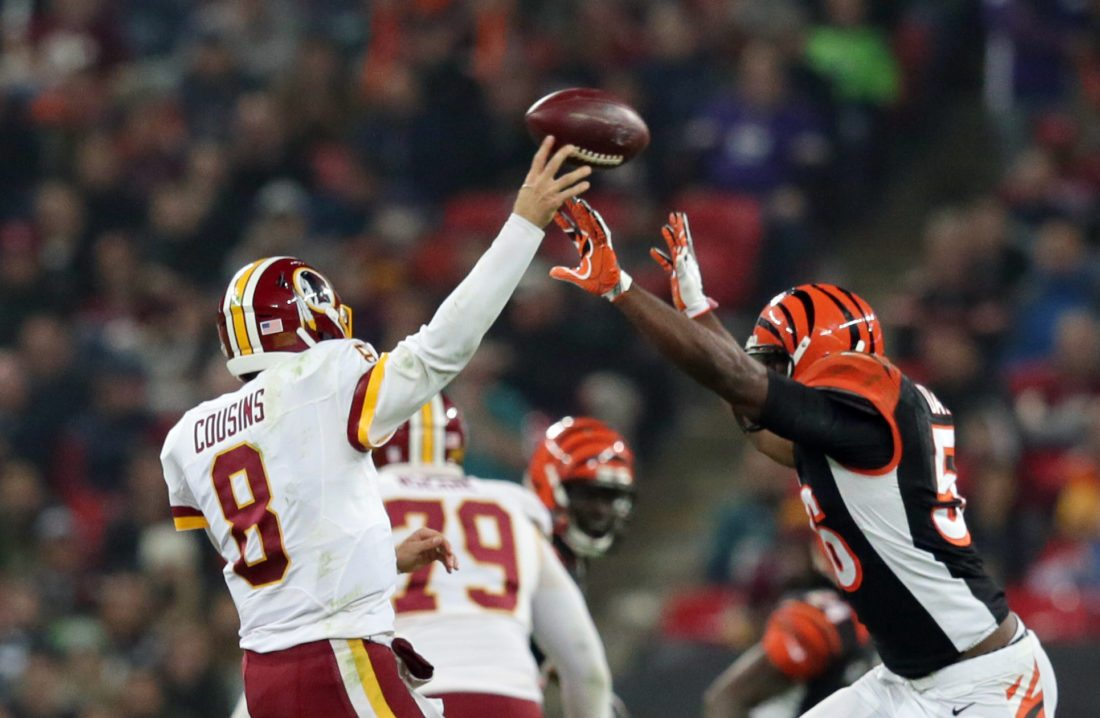 Cincinnati Bengals outside linebacker Karlos Dansby (56) attempts to block the throw of Washington Redskins quarterback Kirk Cousins (8) during an NFL Football game between Cincinnati Bengals and Washington Redskins at Wembley Stadium in London, Sunday Oct. 30, 2016. (AP Photo/Tim Ireland)