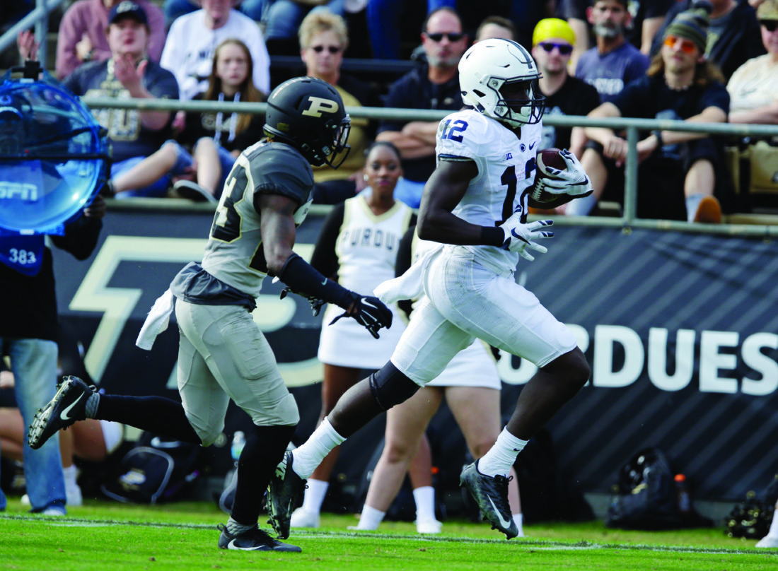 Penn State wide receiver Chris Godwin (12) runs in for a touchdown in front of Purdue cornerback Josh Hayes (23) during the first half of an NCAA college football game in West Lafayette, Ind., Saturday, Oct. 29, 2016. (AP Photo/Michael Conroy)
