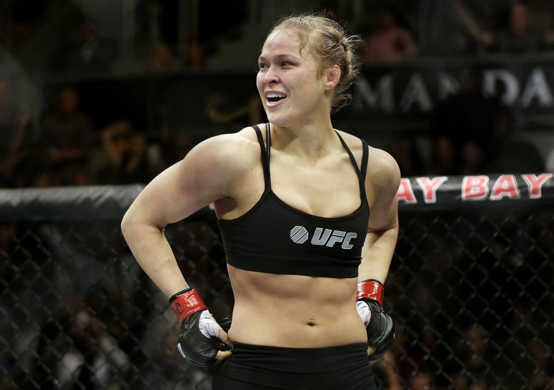 FILE - In this Feb. 22, 2014, file photo, Ronda Rousey looks around after defeating Sara McMann in a UFC 170 mixed martial arts women's bantamweight title bout in Las Vegas. Rousey says her bantamweight title shot against Amanda Nunes at UFC 207 will be one of her final mixed martial arts bouts. Rousey spoke about her fight Tuesday, Nov. 1, 2016, during an appearance on Ellen DeGeneres' talk show. (AP Photo/Isaac Brekken, File)