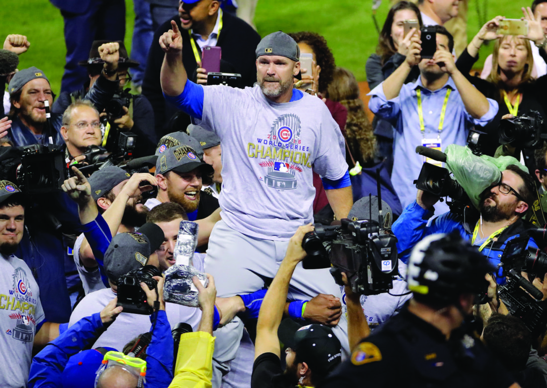Chicago Cubs' David Ross is carried by teammates after Game 7 of the Major League Baseball World Series against the Cleveland Indians Thursday, Nov. 3, 2016, in Cleveland. The Cubs won 8-7 in 10 innings to win the series 4-3. (AP Photo/Gene J. Puskar)