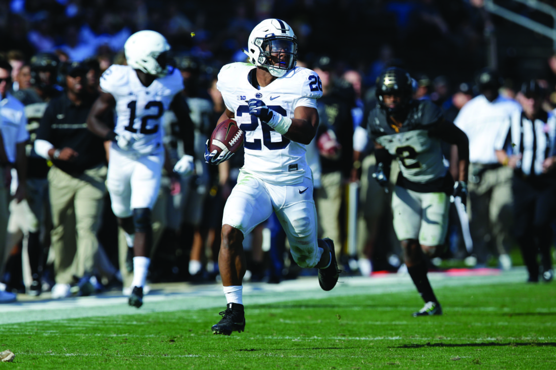 Penn State running back Saquon Barkley (26) scores on a 81-yard run against Purdue during the second half of an NCAA college football game in West Lafayette, Ind., Saturday, Oct. 29, 2016. Penn State defeated Purdue 62-24. (AP Photo/Michael Conroy)