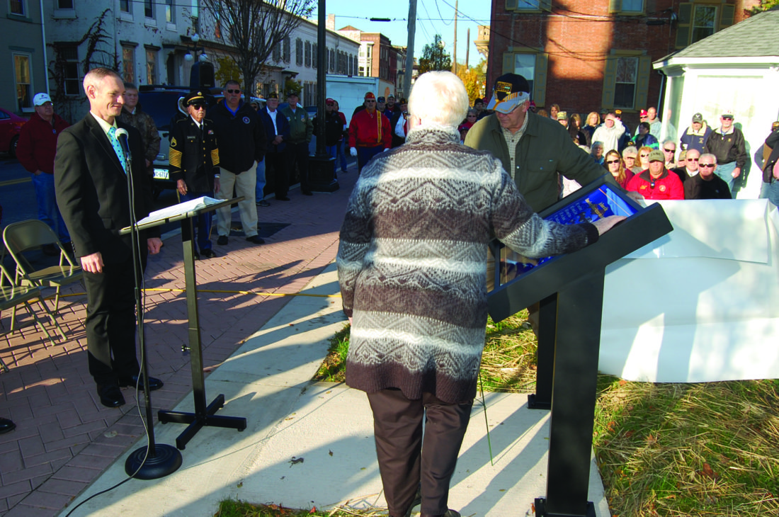 JIM RUNKLE/THE EXPRESS  Ken and Kasren Shadle  unveil the Vietnam Memorial. Spearker Sean MacMillen is seen at left. Below, Army ROTC Color Guard participates in the ceremony.