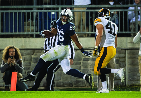 Penn State running back Saquon Barkley glides into the end zone for a touchdown ahead of Iowa linebacker Bo Bower during an NCAA college football game in State College, Pa., Saturday, Nov. 5, 2016. Penn State won, 41-14. (Abby Drey/Centre Daily Times via AP)