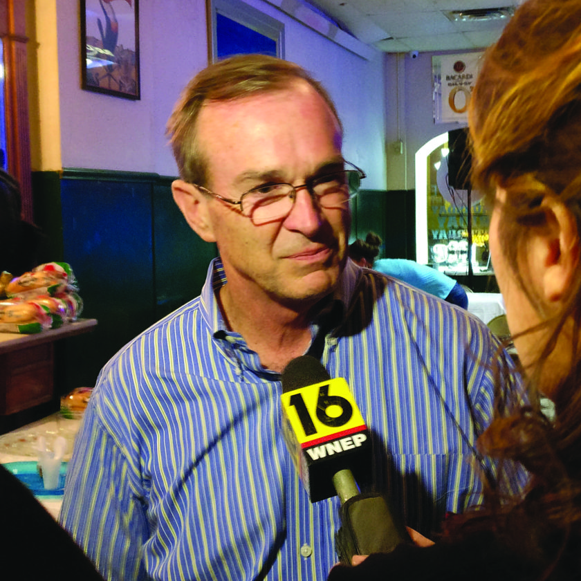 Rep. Mike Hanna speaks with a reporter after learning he won according to unofficial results.