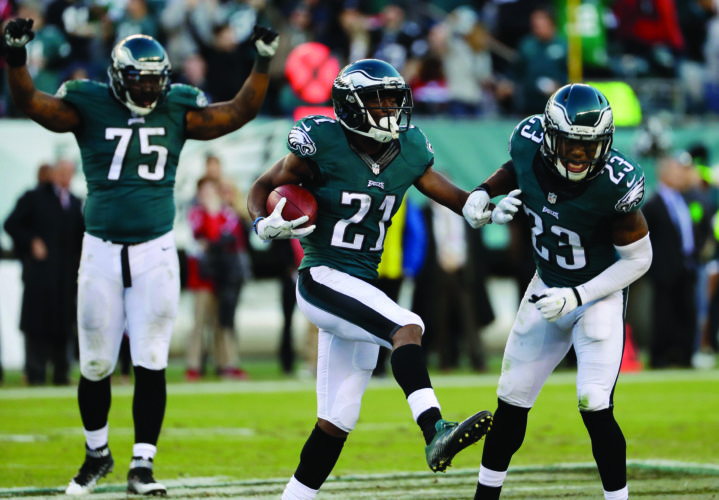 Philadelphia Eagles' Leodis McKelvin, center, celebrates an interception during the second half of an NFL football game against the Atlanta Falcons, Sunday, Nov. 13, 2016, in Philadelphia. (AP Photo/Michael Perez)