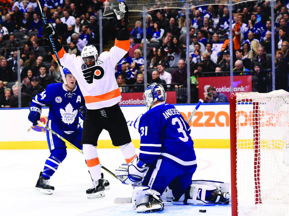Philadelphia Flyers right wing Wayne Simmonds (17) celebrates his goal on Toronto Maple Leafs goalie Frederik Andersen (31) as Maple Leafs defenseman Morgan Rielly (44) looks on during the first period of an NHL hockey game in Toronto, Friday, Nov. 11, 2016. (Nathan Denette/The Canadian Press via AP)