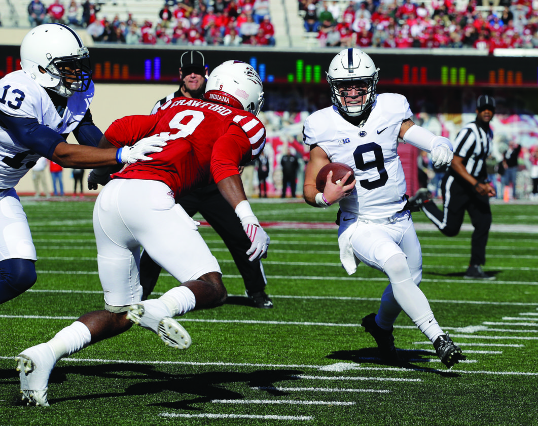 Penn State quarterback Trace McSorley runs 10-yards for a touchdown against Indiana's Jonathan Crawford (9) during the first half of an NCAA college football game Saturday, Nov. 12, 2016, in Bloomington, Ind. (AP Photo/Darron Cummings)