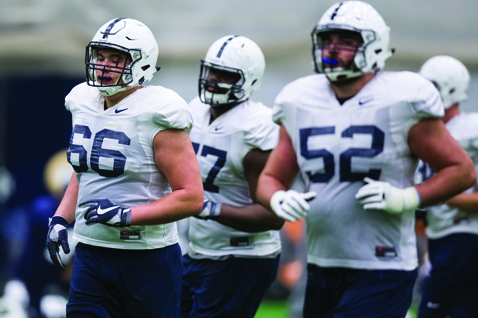 Penn State offensive lineman Connor McGovern (66), offensive tackle Chasz Wright and guard Ryan Bates run drills during football practice in Holuba Hall, Wednesday, Nov. 16, 2016 in State College, Pa. (Joe Hermitt/PennLive.com via AP)