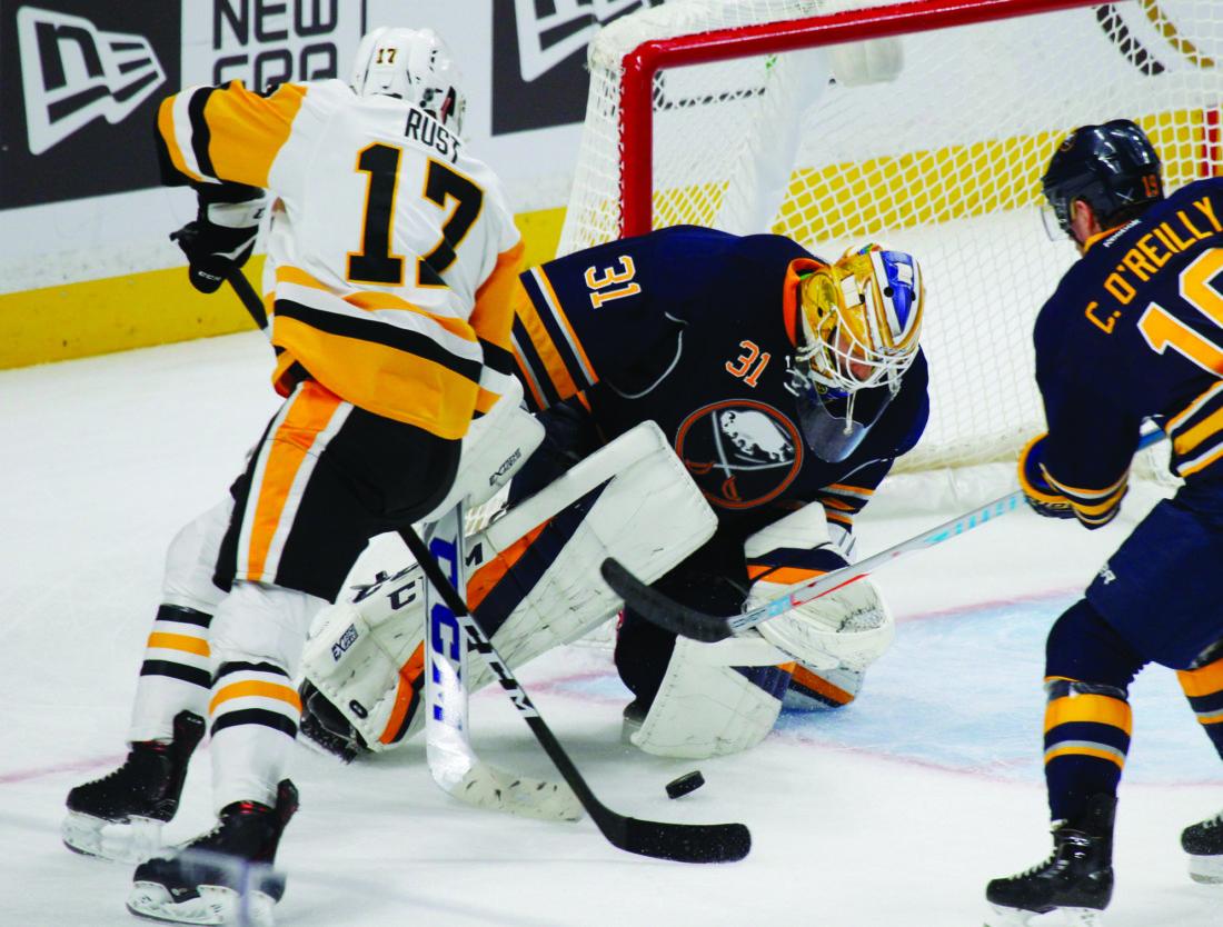 Buffalo Sabres goalie Anders Nilsson (31) stops Pittsburgh Penguins forward Bryan Rust (17) during the third period of an NHL hockey game,Saturday, Nov. 19, 2016, in Buffalo, N.Y. (AP Photo/Jeffrey T. Barnes)