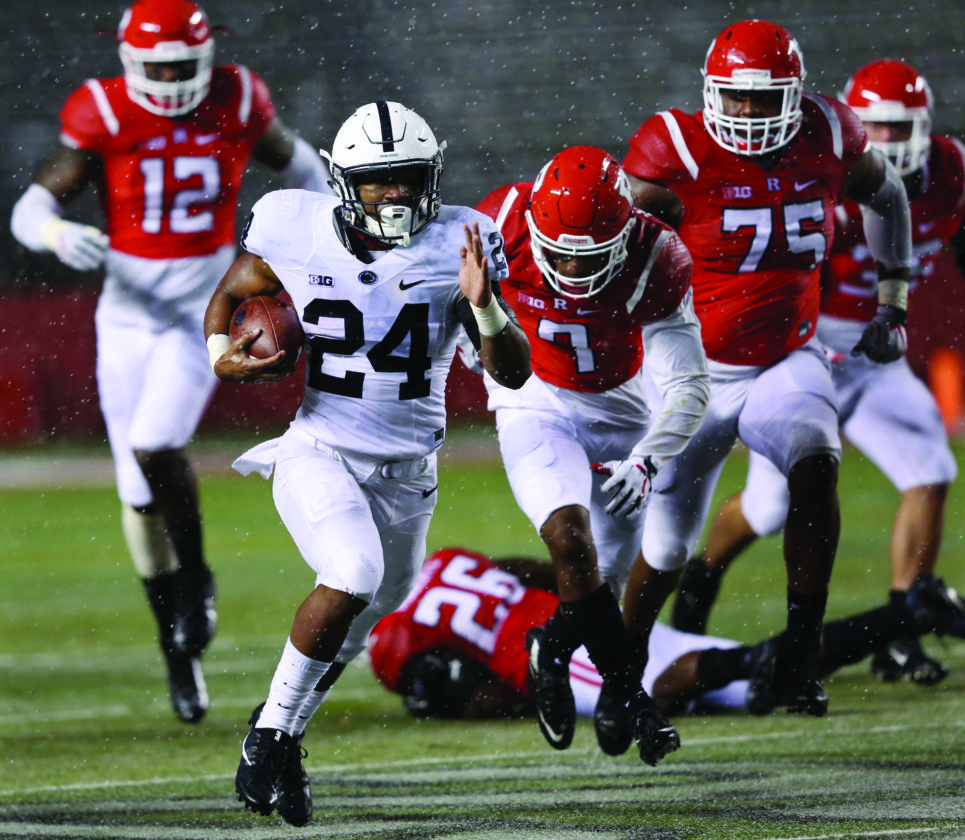 Penn State running back Miles Sanders (24) dashes from the Rutgers defense during the second half of an NCAA college football game Saturday, Nov. 19, 2016, in Piscataway, N.J. Penn State won 39-0. (AP Photo/Mel Evans)
