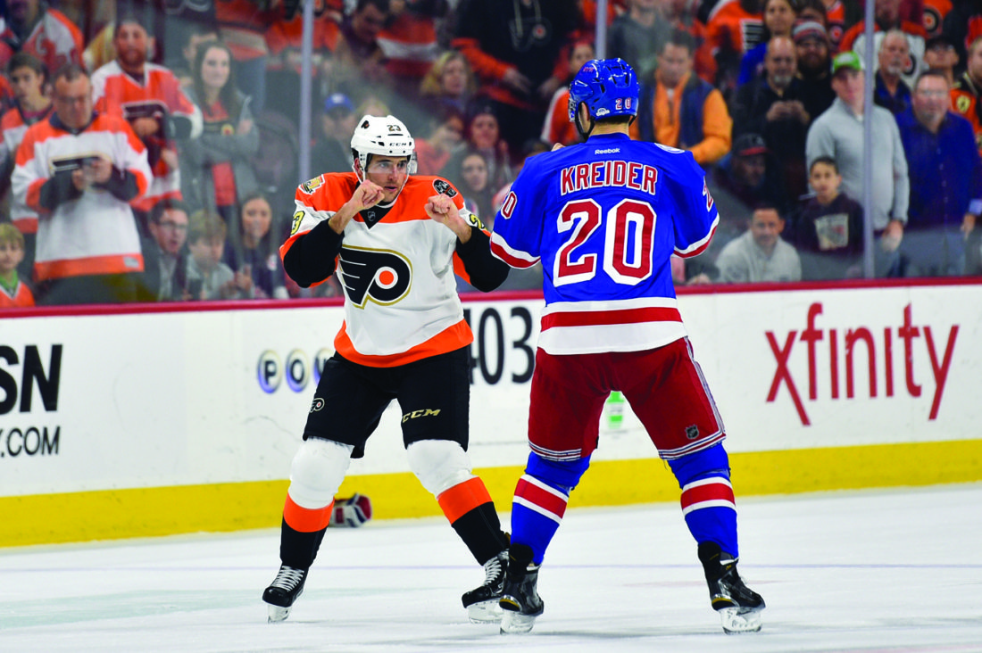 Philadelphia Flyers' Brandon Manning, right, and New York Rangers' Chris Kreider (20) drop the gloves during the first period of an NHL hockey game, Friday, Nov. 25, 2016, in Philadelphia. The Rangers won 3-2. (AP Photo/Derik Hamilton)