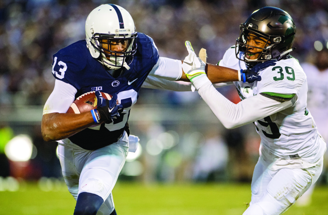 Penn State wide receiver Saeed Blacknall (13) pushes past Michigan State corner back Justin Layne for a first down during an NCAA college football game in State College, Pa., Saturday Nov. 26, 2016. (Abby Drey/Centre Daily Times via AP)