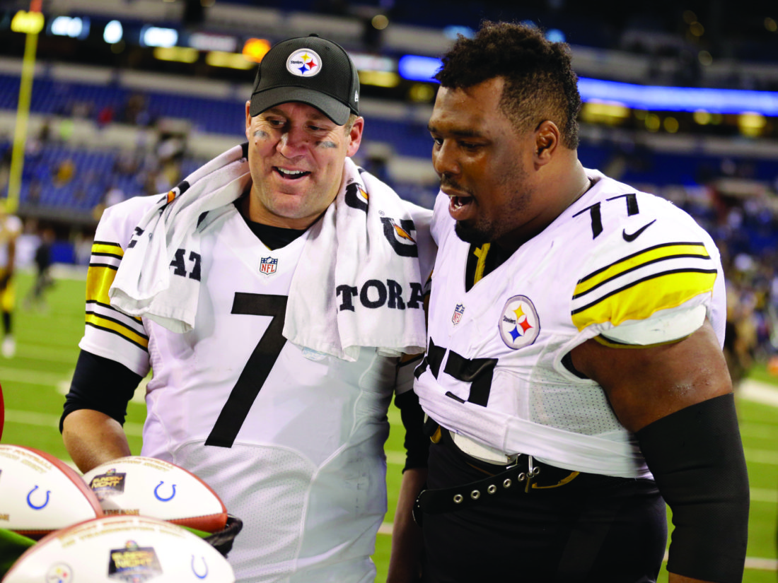 Pittsburgh Steelers quarterback Ben Roethlisberger, left, celebrates with teammate offensive tackle Marcus Gilbert after defeating Indianapolis Colts in an NFL football game Thursday, Nov. 24, 2016, in Indianapolis. Pittsburgh won the game 28-7. (AP Photo/Michael Conroy)