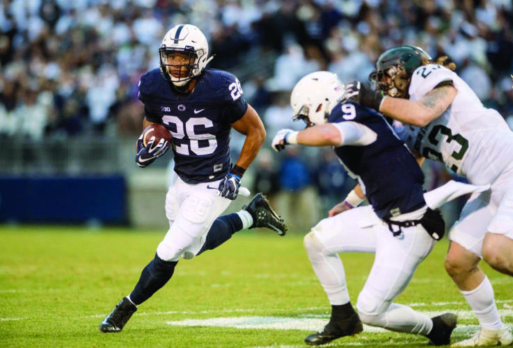 Penn State running back Saquon Barkley runs down the field with the ball as Trace McSorley (9) blocks a Michigan State player during an NCAA college football game in State College, Pa., Saturday Nov. 26, 2016. (Abby Drey/Centre Daily Times via AP)
