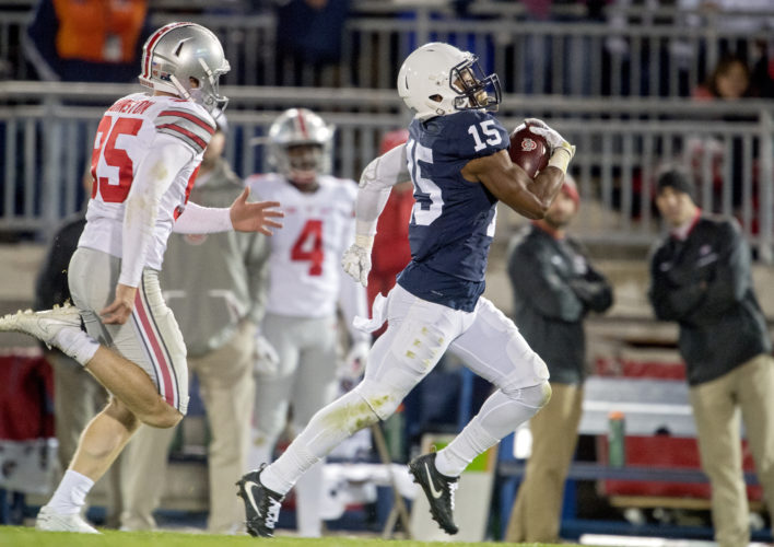 FILE - In this Oct. 22, 2016, file photo, Penn State's Grant Haley returns a blocked field goal for a touchdown against Ohio State in an NCAA college football game, in State College, Pa. The blocked field goal in the fourth quarter against Ohio State changed Penn State's season. The Nittany Lions have not lost since and Happy Valley is happier than it's been with its football team in the five years since a scandal shook the program and the school. (Abby Drey/Centre Daily Times via AP, File)