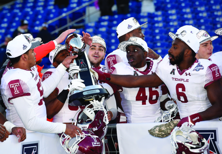Temple players including Stephaun Marshall (6) and Linwood Crump (46) pass around the trophy after they defeated Navy 34-10 in the American Athletic Conference championship NCAA college football game, Saturday, Dec. 3, 2016, in Annapolis, Md. (AP Photo/Nick Wass)