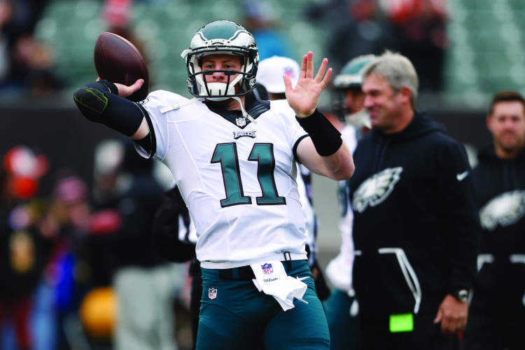 Philadelphia Eagles quarterback Carson Wentz throws during practice before an NFL football game against the Cincinnati Bengals, Sunday, Dec. 4, 2016, in Cincinnati. (AP Photo/Gary Landers)