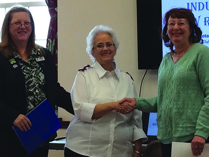PHOTO PROVIDED Salvation Army Maj. Sharon Cupp, center, was recently inducted as a new member in the Rotary Club of Lock Haven. With her are her sponsor, April Welshans, left, who is president of the Lock Haven club, and Wendy Stiver, assistant Rotary district governor who performed the induction.