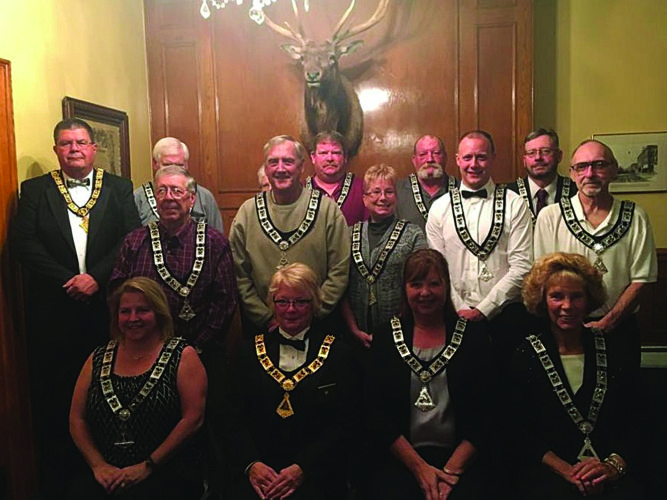 PHOTO PROVIDED The Lock Haven BPO Elks 182 recently elected and installed new officers. The officers are, from left, in front: Esteemed Lecturing Knight Deb Zinck, Exalted Ruler Sherri Walison, PER, Esteemed Leading Knight Becky Young and Inner Guard Carol Confer; in second row: trustees Ken Bressler and Bill Hartle, chaplain Marsha McGinniss, treasurer Jeff Miller, PER, and secretary John Savrock, PER; and in back: PDDGER Mike Zimmerman, trustee Ken Englert, Esteemed Lecturing Knight Phyllis Englert (hidden), trustees Doug Wenker and Cliff Yarnell, and Tiler Bill Passell.