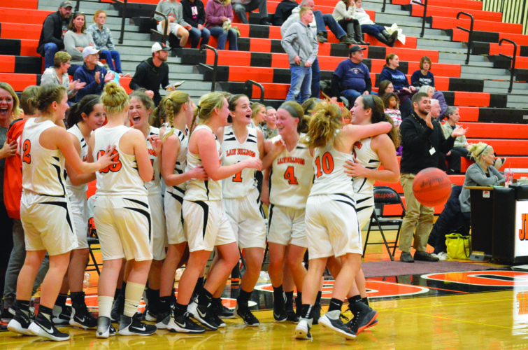 The Jersey Shore High School Bulldogs girls basketball team celebrates its season opening win over the Mifflinburg Wildcats by a score of 31-29. The Bulldogs take on Bellefonte in their next matchup on December 12.