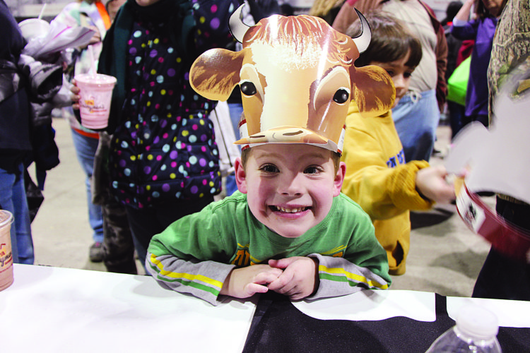 Zach Cooper of Lancaster was all smiles after receiving a free beef cattle visor as part of his visit to Pennsylvania Farm Bureau's exhibit area last January during a visit to the Pennsylvania Farm Show.  PHOTO PROVIDED