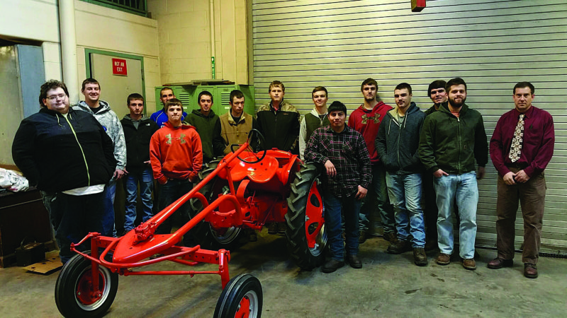 PHOTO PROVIDED Pictured with the 1949 antique Allis Chalmers are members of the class, from left, Seth Darby, Trevor Smith, Gannon Vonada, Trent Rickert, Anthony Underkoffler, Seth Shade, Ryan Courter, Justin Dixon, Heath Wertz, Zach Holdren, Chris Shinn, Austin Swortwood, Brandon Brungard, Austin Herlocher and instructor Paul Bohnert. Missing from the photo are Jake McCauley and Jake Myers.