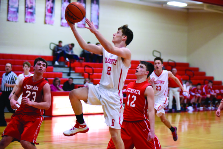 Cade Fortney (12) of Bellefonte High School goes for a layup against the Indians of Juniata. It was a competitive game overall, but the Red Raiders lost this one to Juniata High, 58-48. (The Express/Tim Weight)