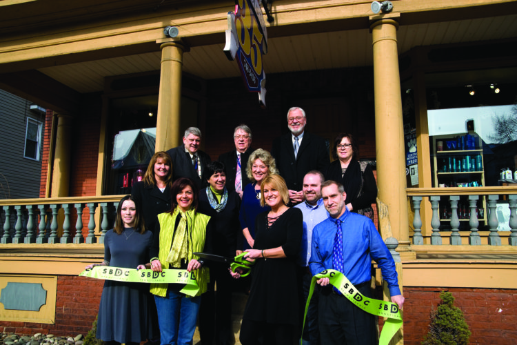Participating in the ribbon cutting ceremony Monday at Hair Studio 35 are, from left, top, Clinton County Commissioners Jeff Snyder, Paul Conklin and Pete Smeltz, and Janaan Maggs; middle, Wendy Salisbury, Julie Brennan, Darlene Weaver, Jason Walker; front, Sydney Weaver, Carol Orndorf, Dana Walker and Tim Keohane.  SPENCER McCOY/ THE EXPRESS