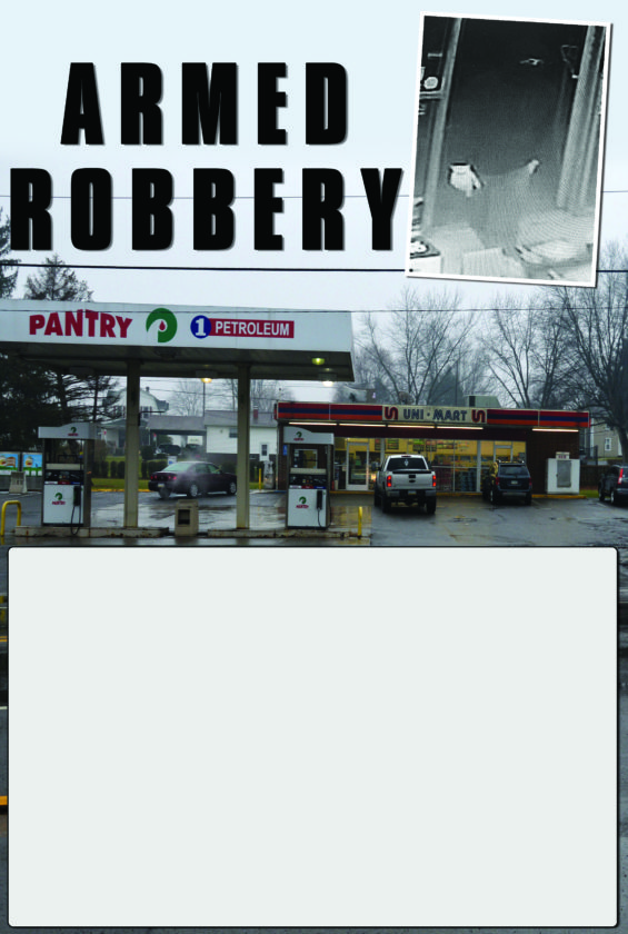 PHOTO PROVIDED/PAUL GARRETT At top:A video camera from inside the Pantry convenience store in Avis shows the armed robber entering the store Monday night. Above: The Pantry convenience store is located at 101 E. Central Ave., Avis.