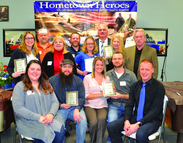LANA MUTHLER/THE EXPRESS Downtown Lock Haven Inc. award winners were announced Thursday night. From left are, in front: Downtown Manager Natasha Gorham, Nicholas Hawrylchak, Ashley and John Kramer, and DLH President Jeff Miller; in the second row: Allison Klugh, Leonora Hannagan, Kristy Eichenlaub, Carol Cillo and Steve Getz; and in back: VFW commander Wayne Litz, Kevin Eichenlaub and Mike Flanagan.