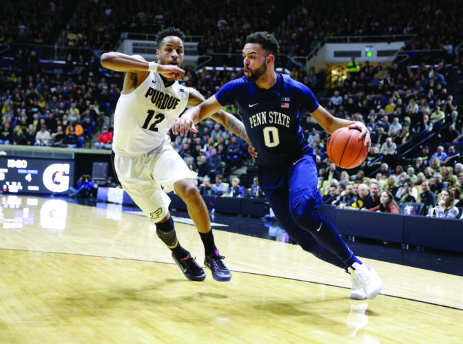 Penn State forward Payton Banks (0) drives on Purdue forward Vince Edwards (12) in the first half of an NCAA college basketball game in West Lafayette, Ind., Saturday, Jan. 21, 2017. (AP Photo/Michael Conroy)