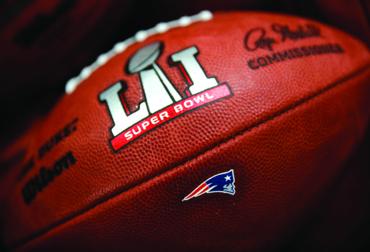 The New England Patriots' NFL Super Bowl LI game ball is finished with the team's logo affixed to it at the Wilson Sporting Goods factory Monday, Jan. 23, 2017, in Ada, Ohio. The Patriots will face the Atlanta Falcons in Super Bowl LI in Houston, Texas on Feb. 5, 2017. (AP Photo/Charles Rex Arbogast)
