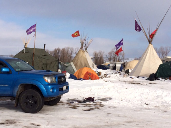 Flags line the main street of a camp at Standing Rock Reservation, N.D.