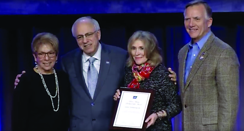 PHOTO PROVIDED June at center right, receives her award from the National American Cancer Society.