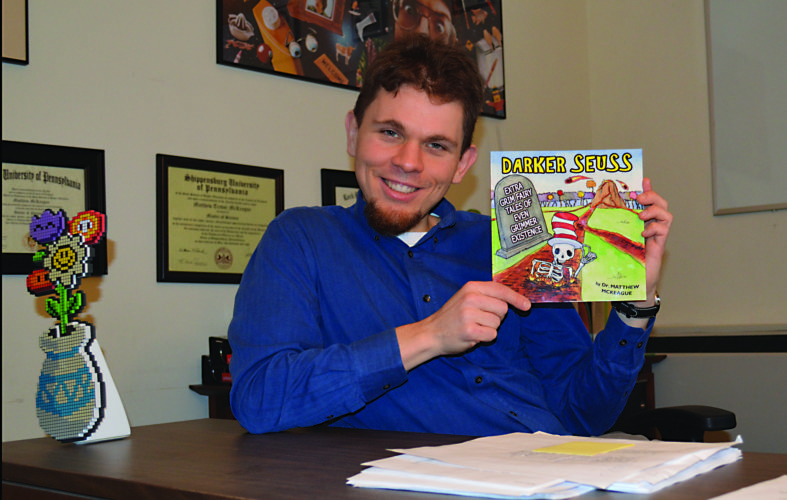 """PHOTO PROVIDED Lock Haven native Matthew McKeague holds the book he authored, """"Darker Seuss:Extra Grim Fairy Tales of Even Grimmer Existence."""""""