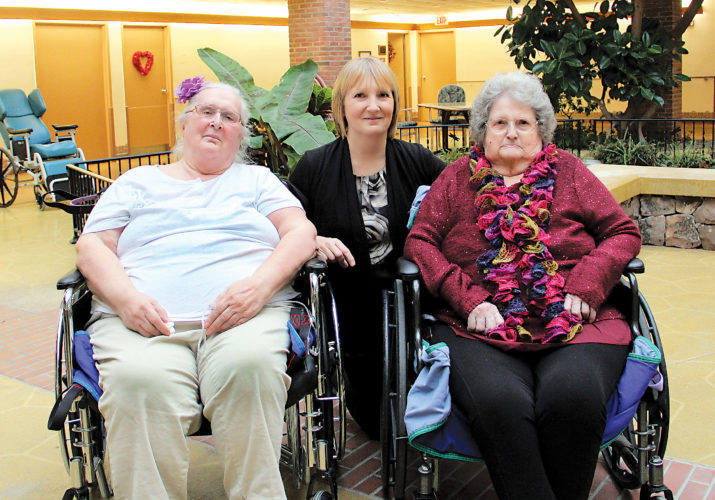 """PHOTO PROVIDED Photographer Sandy Considine takes photographs of Susque-View residents Peggy Bartlebaugh, left, and Lois St. Clair. Their pictures will be included in Sandy's book, """"Beautiful Old Souls,"""" a compilation of photographs of senior citizens."""
