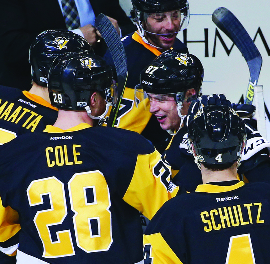 After assisting on a goal by Pittsburgh Penguins' Chris Kunitz, for the 1000th point of his NHL career, Sidney Crosby (87) celebrates with teammates on his way back to his bench during the first period of an NHL hockey game against the Winnipeg Jets in Pittsburgh, Thursday, Feb. 16, 2017. (AP Photo/Gene J. Puskar)