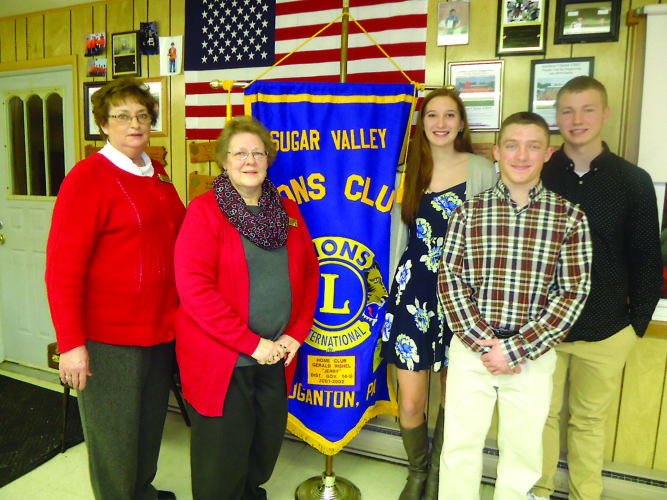 PHOTO PROVIDED At the Sugar Valley Lions Club's February dinner meeting are, from left, club president Donna Mills, club secretary Maureen Albright, and the club's three Students of the Month: Vanessa Soo of Central Mountain High School, Colden Geisewite of Sugar Valley Rural Charter School, and Bryce Mansfield of CMHS.