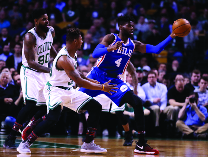 Philadelphia 76ers forward Nerlens Noel (4) passes the ball during the first quarter of an NBA basketball game in Boston, Wednesday, Feb. 15, 2017. (AP Photo/Charles Krupa)