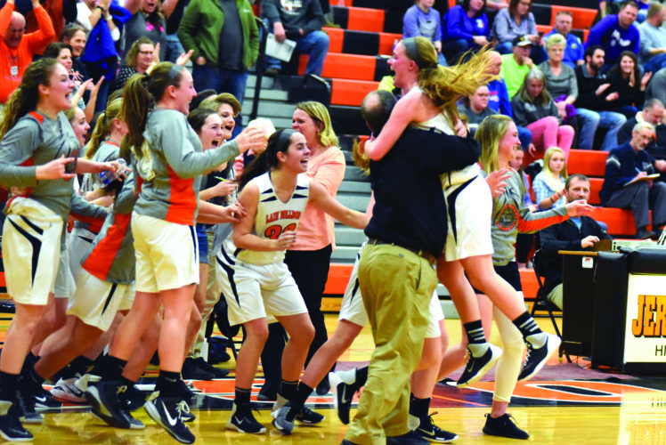 The Jersey Shore High School girls basketball team celebrates after winning the District 4 quarterfinal game. They  defeated Shamokin High School, 43-37, for their first playoff win since 2001. (The Express/Tim Weight)