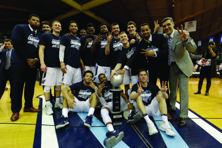 Villanova players and coaches pose with the Big East conference regular season trophy after winning an NCAA college basketball game against Creighton, 79-63, Saturday, Feb. 25, 2017, in Villanova, Pa. (AP Photo/Matt Slocum)