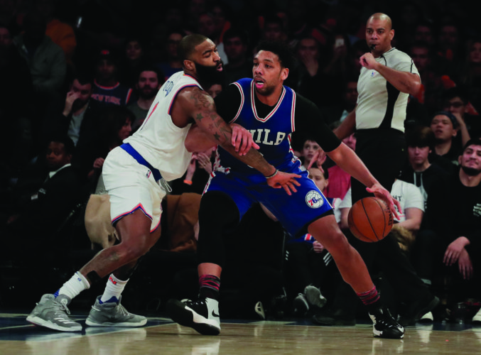 Philadelphia 76ers center Jahlil Okafor (8) drives against New York Knicks center Kyle O'Quinn (9) during the fourth quarter of an NBA basketball game, Saturday, Feb. 25, 2017, in New York. (AP Photo/Julie Jacobson)