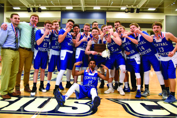 The Central Mountain High School boys basketball team celebrates winning the District Championship after defeating the Hollidaysburg High School Golden Tigers, 65-63. (The Express/Tim Weight)