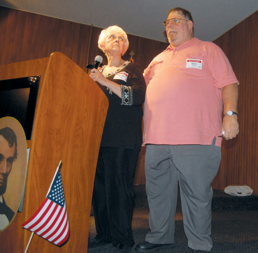 JIM RUNKLE/THE EXPRESS This year's Clinton County Republicans of the Year were a couple— Sam and Karla Hoy. County Republican Party Chairman Kurt Smith presented them as most exemplifying the party through their participation in a large number of events and their dedication to the organization.