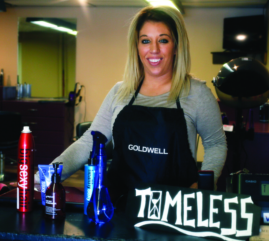 SPENCER MCCOY/FOR THE EXPRESS Jen Miller stands with products in her new hair salon, Timeless.