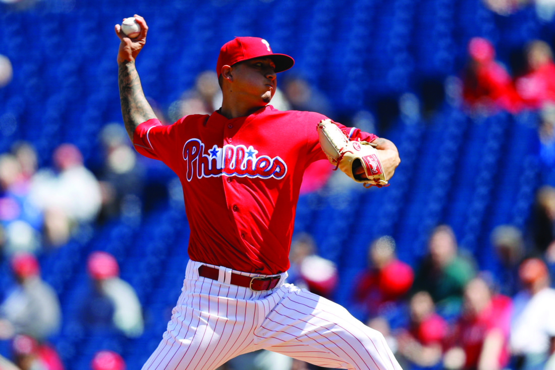 FILE - This April 14, 2016, file photo shows Philadelphia Phillies' Vince Velasquez pitching during the first inning of a baseball game against the San Diego Padres in Philadelphia. A dazzling, 16-strikeout performance was the best and worst thing that happened to Vince Velasquez last season. The hard-throwing righty quickly showed his electric stuff in his second start with the Phillies, tossing a three-hitter with no walks and 16 Ks against San Diego last April.ÊBut Velasquez spent the rest of the season trying to do it again. (AP Photo/Matt Slocum, File)