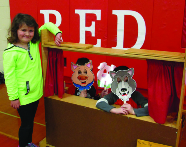 "A new activity at Bellefonte READS was a puppet show. Shown here is Kaitlyn Gutierrez, 6, who was the storyteller, Cole Giornesto, 7, who played the part of ""the little pigs,"" and Alex Giornesto, 5, who played the part of ""the big bad wolf."""