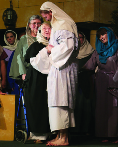 PHOTO COURTESY OF MICHELLE PETERS PHOTOGRAPHY Jesus (Jared Moore) heals the crippled woman (Marge Haagen, the oldest cast member at age 92).