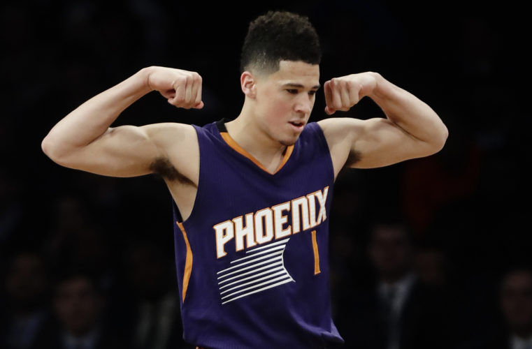 The Suns' Devin Booker celebrates after scoring during the first half of a game against the Nets on Thursday, March 23, 2017, in New York. (Frank Franklin II/AP Photo)