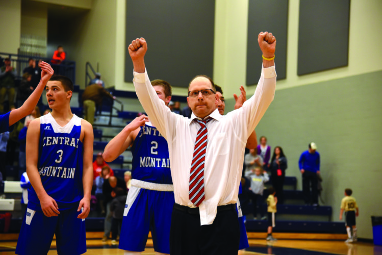 Coach Scott Baker celebrating after his Central Mountain Wildcats won the District Championship. Baker recently announced that he's resigning from the Central Mountain basketball program after 16 years as head coach. (The Express/Tim Weight)